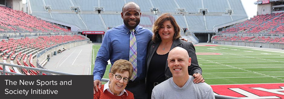 The four founding members of the Sports and Society Initiative pose in the Ohio Stadium.